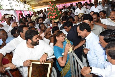 CM KCR distributes pattas to the poor people