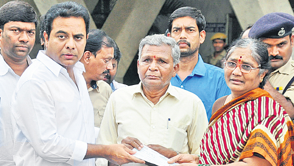 KTR handedover the cheque to the gokul chat bomb blast victim families